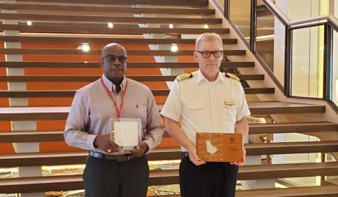 1.	BPI Manager Property Management, Maintenance and Projects, Mr. Ian Stewart (left) and Captain Lars Kjeldsen as they exchanged commemorative plaques to mark the inaugural visit of the Viking Sun.